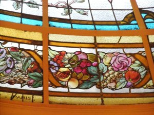 Stained glass, mirrors and lighting in the 'belle epoche' style.