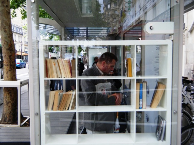 'Old technology': a real book library at the Gare de Lyon bus shelter.