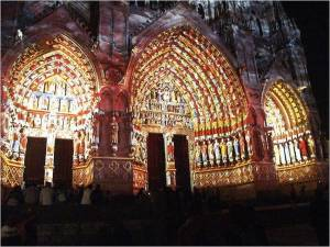 Amiens cathedral, the lightshow photo from Wikimedia shows the original colours of the facade.