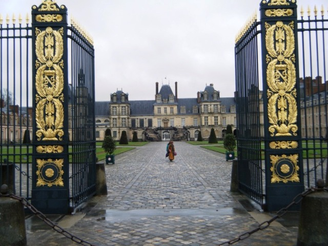 Looking across the impressive courtyard of Chateau Fontainebleau to the famous horseshoe-shaped staircase.