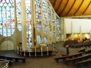 Inside Rouen Joan of Arc church, modern but with the stained glass windows which were saved from WWII bombing.
