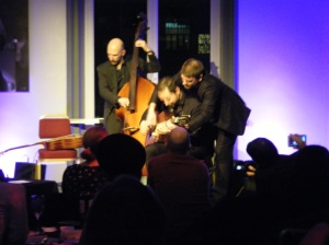 The Robin Nolan Trio, brothers share the guitar as a party trick.