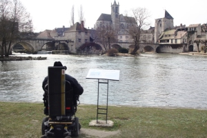 Stewart studying the Alfred Sisley painting and then the scene he painted in 1891.