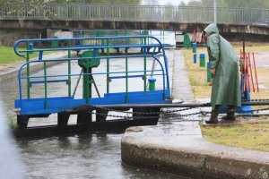 One of our lock-keepers operating the manual system, in the pouring rain.