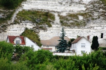 Houses built into the white cliffs.