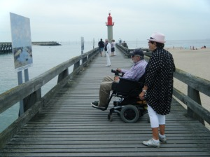 Trouville pier and an exhibition of Impressionists paintings of the region.