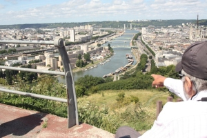 Stewart points to Endellion moored way down below on the Seine at Rouen.