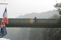 French Waterways staff fix a new sign on the bridge above us. Foggy mornings coming.