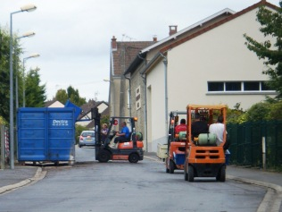 After pressing the grape clusters, queues for the bin.