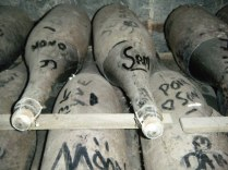 Graffiti even on the ancient bottles of Champagne deep in the undergound cellars.