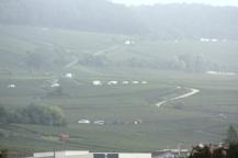 Vendanges activity on hills one misty morning.