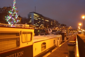 "Happily moored at the Port de l'Arsenal, Christmas tree merrily saying ""Happy Festive Season""."
