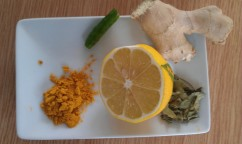 Fresh ginger, lemon, chilli, curry leaves and turmeric.