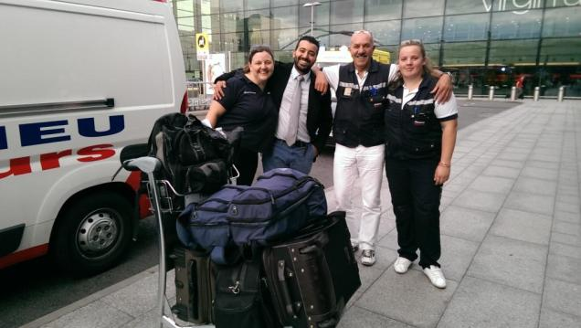 A greatly relieved crew, Melinda on the left with the taxi driver, Lucien and his side-kick - at Heathrow airport.